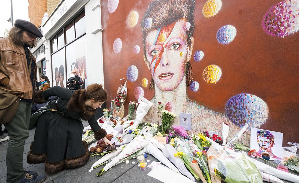 People pay respects and tribute to local hero David Bowie in Brixton